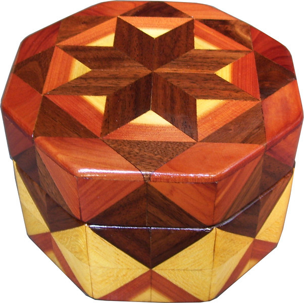 "Oct Box Light behind Star<br />   This Octagon Box measures 5"" x 5"" and is 3 ¼"" tall.  There are 128 pieces on the box in the diamond and triangle shape.  The box is finished in its natural color with 5 or 6 coats of a clear wiping varnish rubbed in by hand.  The pieces are a bit over 3/16"" thick glued onto a Baltic Birch base.  The type of wood is listed on the bottom of the box from the center out.  On this box is ""Walnut"", ""Cedar"" and ""Hackberry"" from Missouri.<br /> <br />    On this box it looks like it has a ""light behind the star"".<br />  It is lined with black velveteen."