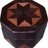 "Oct Box Wenge-Wal<br />   This Octagon Box measures 5"" x 5"" and is 3 ¼"" tall.  There are 128 pieces on the box in the diamond and triangle shape.  The box is finished in its natural color with 5 or 6 coats of a clear wiping varnish rubbed in by hand.  The pieces are a bit over 3/16"" thick glued onto a birch plywood base.  The type of wood is listed on the bottom of the box from the center out.  On this box is ""Wenge"" from West Africa and ""Walnut"" from Missouri.  It is lined with black velveteen."