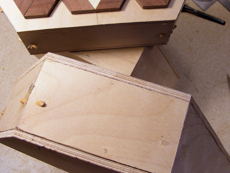 "Detail of the Corners of the Hex Box Base.<br /> With the little pieces not being able to help tie the corners together, I drilled a 1/8th"" hole through the corner and glued a dowel in the hole. Then I just sand the ends flush with the sides of the box and the joint has a little more strength to it."