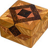 "Tiny Sq Sw-Lw Box<br />  The type of wood is listed on the bottom of the box from the center out. On this box the wood is ""Ziricote"" from South America, ""Pink Ivory"" from South Africa (a wood that is sacred to the Zulu tribe). ""Black Palm"" from Indonesia. (I cut this on an angle to give the black dots a different look) ""Lacewood"" from Australia is a wood that has a nice coppery sheen to it. Then ""Satinwood"" from Sri Lanka is used on the main part of the box. Satinwood has the most beautiful golden satiny luster to it.  <br />      On the bottom I signed it, listed the wood, and dated it.  After the date, the words ""Foot Cut"" let you know I made it on a foot powered table saw.<br /> <br />      This box is all made from very exotic wood.<br />  <br />      I lined the box with black velveteen.   <br /> <br />      This box may be prettier than a lot of the jewelry that could go in it."