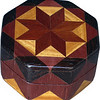 """Bloodwood Star Ring Box<br />  This is my """"Bloodwood Star"""" Ring Box.  It measures 3 1/2"""" x 3 1/2"""" and is 2"""" high.  There are 72 pieces, both full and half size diamonds and triangles, on this box.  On the top there are 32 half size pieces where it would normally have 16 full size pieces.  It is finished in its natural color with 5 or 6 coats of clear wiping varnish, rubbed in by hand.  The pieces are a bit over 3/16"""" thick, glued onto a Baltic Birch base.  <br /> <br />     The type of wood is listed on the bottom of the box from the center out.  On this box is """"Bloodwood"""" from South America, """"Satinwood"""" from Sri Lanka, """"Purpleheart"""" from Central or South America and """"Wenge"""" from West Africa.  <br /> <br />     I made this box in 1996.  On the bottom I signed it, listed the wood, and dated it.  After the date, the words """"Foot Cut"""" let you know I made it on a foot powered table saw.<br /> <br />     It is lined with black velveteen.  It has 3 """"ring pads"""" on the bottom forming 2 slots about 2 ½"""" long, for rings."""