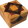 "Tiny Sq Oak Box<br />  I call this my ""Tiny Square Oak"" Box. On the top of the box is an ""Aunt Sukeys Choice"" quilt pattern.  The square box is about 3 1/2"" x 3 1/2"" and 2 1/2"" tall. Inside it is 2 1/2"" x 2 1/2"" x 1 1/2"".  I made it using 92 pieces of wood cut in either diamond or triangle shapes from different kinds of wood. I used the half size pieces for the ""Aunt Sukeys Choice"" pattern on the top, so there are 40 pieces where I would normally have 20 pieces. The box is finished in its natural color with 5 or 6 coats of a clear wiping varnish, rubbed in by hand. The pieces are a bit over 3/16"" thick, glued onto a Baltic Birch base, so they hold up much better than a thin veneer.<br />    The type of wood is listed on the bottom of the box from the center out. On this box the wood is ""Satinwood from Sri Lanka, ""Walnut"" from Missouri, ""Wenge"" from West Africa, ""Purpleheart"" from Central or South America and ""Oak"" from Missouri.<br />     On the bottom I signed it, listed the wood, and dated it.  After the date, the words ""Foot Cut"" let you know I made it on a foot powered table saw.<br />  <br />    I lined the box with black velveteen."