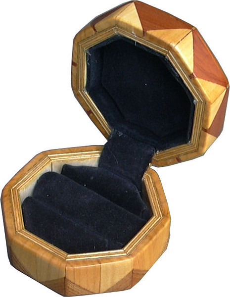 "Elm-Cedar-Cw Ring Box<br /> This is my ""Elm, Cedar and Cottonwood"" Ring Box.  It measures 3 1/2"" x 3 1/2"" and is 2"" high.  There are 56 pieces on this box.  The pieces are all the ""full size"" diamonds and triangles, except for the 16 half size triangles around the bottom.  It is finished in its natural color with 5 or 6 coats of clear wiping varnish rubbed in by hand.  The pieces are a bit over 3/16"" thick, glued onto a Baltic Birch base.  So they hold up much better than a thin veneer.  <br /> <br />   The type of wood is listed on the bottom of the box, from the center out.  On this box is ""Elm, Cedar and Cottonwood"" from Missouri.  <br /> <br />   I made this box in 1996.  On the bottom I signed it, listed the wood, and dated it.  After the date the words ""Foot Cut"" let you know I made it on a foot powered table saw.  My brother helped me make the saw around 1992.  <br /> <br />   The inside is lined with black velveteen.   It has 3 ""ring pads"" on the bottom forming 2 slots about 2 ½"" long, for rings."