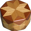 """Elm-Cedar-Cw Ring Box<br /> This is my """"Elm, Cedar and Cottonwood"""" Ring Box.  It measures 3 1/2"""" x 3 1/2"""" and is 2"""" high.  There are 56 pieces on this box.  The pieces are all the """"full size"""" diamonds and triangles, except for the 16 half size triangles around the bottom.  It is finished in its natural color with 5 or 6 coats of clear wiping varnish rubbed in by hand.  The pieces are a bit over 3/16"""" thick, glued onto a Baltic Birch base.  So they hold up much better than a thin veneer.  <br /> <br />   The type of wood is listed on the bottom of the box, from the center out.  On this box is """"Elm, Cedar and Cottonwood"""" from Missouri.  <br /> <br />   I made this box in 1996.  On the bottom I signed it, listed the wood, and dated it.  After the date the words """"Foot Cut"""" let you know I made it on a foot powered table saw.  My brother helped me make the saw around 1992.  <br /> <br />   The inside is lined with black velveteen.   It has 3 """"ring pads"""" on the bottom forming 2 slots about 2 ½"""" long, for rings."""