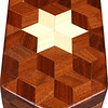 "Small Walnut Hexagon Box, view 2<br /> The Small Walnut Hexagon Box is based on the ""Tumbling Block"" quilt pattern except that it is all walnut but for the six pointed star. It measures 4 3/8"" X 8 3/8"" and 2 3/8"" high. Inside measurements are 3 ¼"" X 7"" X 1 ½"".  There are 148 pieces on the overlay. The pieces are cut and glued in place, one piece at a time. The pattern covers the top and extends over the edge uninterrupted, to the bottom. The box is finished in its natural color with 5 or 6 coats of a clear wiping varnish, rubbed in by hand. The pieces are a bit over 3/16"" thick, glued onto a Baltic Birch base<br /> <br /> This box is made from Hackberry, and Walnut, both native to Missouri. I lined the box with black velveteen."
