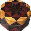 "Wenge Star Ring Box<br />  This is my ""Wenge Star"" Ring Box.  It measures 3 1/2"" x 3 1/2"" and is 2"" high.  There are 72 pieces, both full and half size diamonds and triangles, on this box.  On the top there are 32 half size pieces where it would normally have 16 full size pieces.  It is finished in its natural color with 5 or 6 coats of clear wiping varnish, rubbed in by hand.  The pieces are a bit over 3/16"" thick, glued onto a Baltic Birch base.  <br /> <br />   The type of wood is listed on the bottom of the box from the center out.  On this box is ""Wenge"" from West Africa, ""Purpleheart"" from Central or South America, and ""Satinwood"" from Sri Lanka.  <br /> <br />    On the bottom I signed it, listed the wood, and dated it.  After the date, the words ""Foot Cut"" let you know I made it on a foot powered table saw.<br /> <br />   It is lined with black velveteen.  It has 3 ""ring pads"" on the bottom forming 2 slots about 2 ½"" long, for rings."