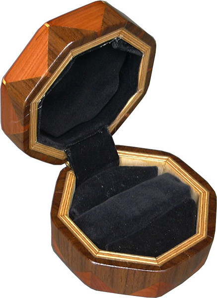 "Hb-Cedar-Wal Ring Box<br />  This is my ""Hackberry, Cedar and Walnut"" Ring Box.  It measures 3 1/2"" x 3 1/2"" and is 2"" high.  There are 56 pieces on this box.  The pieces are all the ""full size"" diamonds and triangles, except for the 16 half size triangles around the bottom.  It is finished in its natural color with 5 or 6 coats of clear wiping varnish rubbed in by hand.  The pieces are a bit over 3/16"" thick, glued onto a Baltic Birch base.  So hold up much better than a thin veneer.  <br /> <br />   The type of wood is listed on the bottom of the box, from the center out.  On this box is ""Hackberry, Cedar and Walnut"" from Missouri.  <br /> <br />   I made this box in 1997.  On the bottom I signed it, listed the wood, and dated it.  After the date the words ""Foot Cut"" let you know I made it on a foot powered table saw.  My brother helped me make the saw around 1992.  <br /> <br />   The inside is lined with black velveteen.   It has 3 ""ring pads"" on the bottom forming 2 slots about 2 ½"" long, for rings."