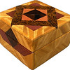 "Tiny Sq Sw-Ph Box<br /> All the natural colors of the different kinds of wood.<br /> <br />  I call this my ""Tiny Square Satinwood and Purpleheart"" Box. On the top of the box is an Aunt Sukeys Choice quilt pattern. The square box is about 3 1/2"" x 3 1/2"" and 2 1/2"" tall. Inside it is 2 1/2"" x 2 1/2"" x 1 1/2"". I made it using 92 pieces of wood cut in either diamond or triangle shapes from different kinds of wood. I used the half size pieces for the ""Aunt Sukeys choice"" pattern on the top, so there are 40 pieces where I would normally have 20 pieces. The box is finished in its natural color with 1 coat of varnish brushed on and 3 coats of a clear wiping varnish, rubbed in by hand. The pieces are a bit over 3/16"" thick, glued onto a Baltic Birch base, so they hold up much better than a thin veneer.<br />  The type of wood is listed on the bottom of the box from the center out. On this box the wood is ""Ziricote"" from South America, ""Pink Ivory"" from South Africa (a wood that is sacred to the Zulu tribe). ""Black Palm"" from Indonesia. (I cut this on an angle to give the black dots a different look) ""Purpleheart"" from Central or South America is a very bright purple wood. Then ""Satinwood"" from Sri Lanka is used on the main part of the box. Satinwood has the most beautiful golden satiny luster to it. <br /> I made this box in 2004. On the bottom I signed it, listed the wood, and dated it. After the date, the words ""Foot Cut"" let you know I made it on a foot powered table saw."