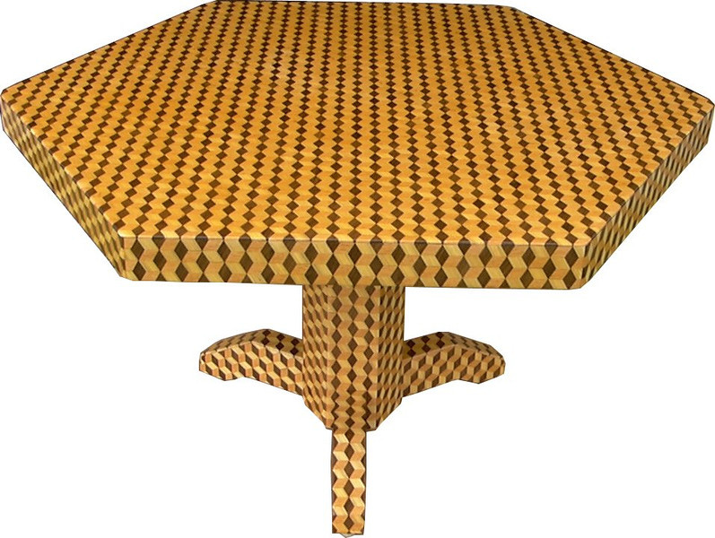 """Table Lg TB Straight Up 1<br /> View #3 -    I call this my """"Large Tumbling Block"""" table. The pattern on table is the """"Tumbling Block"""" quilt pattern. The table stands 30"""" tall and is 47 1/4"""" wide and 54 ½"""" long. There are almost 6000 pieces on the entire table. The pieces are used over the edge and onto the pedestal and feet of the table. The table is finished in its natural color with 6 or 8 coats of varnish. After the varnish hardens for at least a month, I level it and buff it to a high shine. The pieces are a bit over 3/16"""" thick, glued onto a Baltic Birch base, so they hold up much better than a thin veneer.<br />        The pattern has the illusion of a lot of blocks but there are as many stars as there are blocks. The design forces you to see the blocks.  On each diamond, if you go to the side you are in the middle of a block.  At each point you are in the middle of a star that has 6 points.  <br />      The type of wood is listed on the bottom of the table usually from the center out but on this pattern all 3 kinds of wood are equally close to the center. On this table the light wood is """"Ash"""", the dark wood is """"Walnut"""" and the other is """"Oak"""", all from Missouri.<br />      The 3 pictures show how the pattern goes over the edge and seems to change compared to the adjoining side. Opposite sides of the pedestal are the same, adjoining sides are different corresponding to the pattern going over the edge of the table from the top. It gives a different look to each foot on the table. The design does have a continuity going to the adjoining side of either the pedestal or edge of the table.    <br />     I made this table in 2000 and got it finished in 2001. It is large table number 11. On the bottom I signed it, listed the wood, dated it and put the number of the table."""