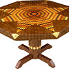 "Table Lg Flickering Star Wal 1<br />    I call this my ""Large Flickering Lone Star"" Walnut table. The pattern on the table is the ""Lone Star"" quilt pattern. The flickering part comes because I alternated light and dark wood, which gives it the illusion of movement. You can sometimes have a light headed feeling when you see it; it plays with your eyes. The table stands 30"" tall and is 47"" wide. There are over 6000 pieces on the entire table. The pieces are used over the edge and onto the pedestal and feet of the table. The table is finished in its natural color with 6 or 8 coats of varnish. After the varnish hardens for at least a month, I level it and buff it to a high shine. The pieces are a bit over 3/16"" thick, glued onto a Baltic Birch base, so they hold up much better than a thin veneer.<br />    The type of wood is listed on the bottom of the table from the center out. (1) ""Pink Ivory"" from South Africa, (2) ""Gabon Ebony"" from Africa, (3) ""Tulipwood"" from Brazil, (4) ""Redwood Burl"" from California, (5) ""Sumac"" from upstate New York, (6) ""Monkey Pod Wood"" from Hawaii, (7) ""Kentucky Coffee"" from Kentucky, (8) ""Purpleheart"" from Central or South America, (9) ""Satinwood from Brazil, (10) ""Chechem"" from Mexico, (11) ""Sycamore"" from Missouri, (12) ""Lacewood"" from Australia, (13) ""Oak"" from Missouri, (14) ""Wenge"" from West Africa, (15) Birds Eye Maple"" from Eastern US, (16) ""Bloodwood"" from South America, (17) ""Zebrawood"" from West Africa, (18) ""Black Limba"" from Africa, (19) ""Tree Of Heaven"" from US but native to China, (20) ""Macassar Ebony"" from the East Indies, (21) ""Satinwood"" from Sri Lanka, (22) ""Smoke Tree"", (23) ""Hackberry"" and (24) ""Walnut"" from Missouri.<br />    I made this table in 2000 and got it finished in 2001. It is large table number 14. On the bottom I signed it, listed the wood, dated it and put the number of the table. As with everything I make I can find flaws in each item, be it box or table. It's not perfect but you'll look a long time to find a prettier table."