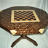 Lg Chess Table  1990<br /> In 1990 I made this large chess table for a man so he could play chess with his son while they ate. He liked it so much he got two more for his other two children.<br /> I used different wood on the other two table's chess boards.