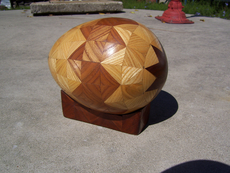 """Egg, 7 1/2"""" Long x 5 1/2"""" Tall<br /> In 1987 I made 2 or 3 eggs, about 7 ½"""" long x 5 ½"""" tall, but I quickly saw I wanted the edges of things round, not the whole thing. On my boxes, lazy susans, tables and all, I round the edges; it has lot more pleasing feel in your hand than a square edge. I always figured that was why God made women more rounded, rather than with square edges."""