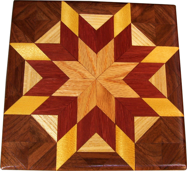 """Bright Morning Star  Quilt Block<br /> This is a """"Bright Morning Star"""" quilt block. It is made using diamonds and triangles from different kinds of wood, all in their natural colors. I used some bright exotic wood on this one. There are 80 pieces on this block, 32 diamonds and 48 triangles, all full size. It measures 7"""" square. To finish them, I use one coat of varnish brushed on and 2 or 3 coats of a clear wiping varnish, rubbed in by hand. <br />    The type of wood is listed on the bottom from the center out. On this quilt block the wood is """"Oak"""" from Missouri, """"Purple Heart"""" from Central or South America, """"Satinwood"""" from Brazil, """"Hackberry"""" and """"Walnut"""" from Missouri."""