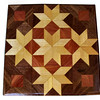 "Stars and Cubes<br />   This is a ""Stars and Cubes"" quilt block. It is made using diamonds and triangles from different kinds of wood, all in their natural colors. There are 108 pieces on this block, 48 diamonds and 60 triangles, all full size. It measures 8 ½"" square. To finish them, I use 5 or 6 coats of a clear wiping varnish, rubbed in by hand <br /> <br />    The type of wood is listed on the bottom from the center out. On this quilt block the wood is ""Cottonwood"", ""Cedar"", and ""Walnut"" from Missouri.<br />  <br />    On the bottom I signed it, listed the wood, and dated it.  After the date, the words ""Foot Cut"" let you know I made it on a foot powered table saw."