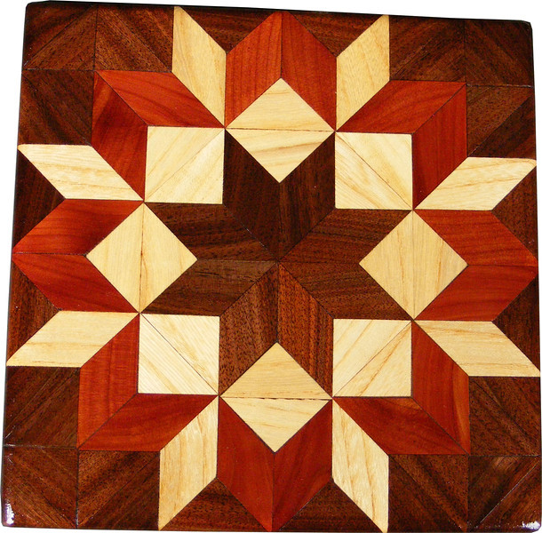 """Walnut Carpenters Wheel Quilt Block<br /> This is a """"Walnut Carpenters Wheel"""" quilt block. It is made using diamonds and triangles from different kinds of wood, all in their natural colors. There are 80 pieces on this block, 32 diamonds and 48 triangles, all full size. It measures 7"""" square. To finish them, I use 5 or 6 coats of a clear wiping varnish, rubbed in by hand.<br /> <br /> The type of wood is listed on the bottom from the center out. On this quilt block the wood is """"Walnut"""", """"Hackberry"""" and """"Cedar"""" from Missouri."""