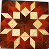 "Walnut Carpenters Wheel Quilt Block<br /> This is a ""Walnut Carpenters Wheel"" quilt block. It is made using diamonds and triangles from different kinds of wood, all in their natural colors. There are 80 pieces on this block, 32 diamonds and 48 triangles, all full size. It measures 7"" square. To finish them, I use 5 or 6 coats of a clear wiping varnish, rubbed in by hand.<br /> <br /> The type of wood is listed on the bottom from the center out. On this quilt block the wood is ""Walnut"", ""Hackberry"" and ""Cedar"" from Missouri."