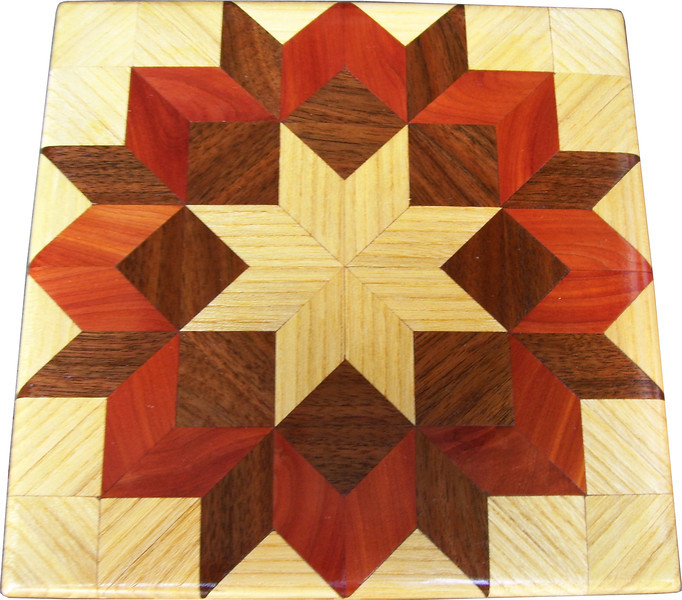 """Hackberry Carpenters Wheel Quilt Block<br />   This is a """"Hackberry Carpenters Wheel"""" quilt block. It is made using diamonds and triangles from different kinds of wood, all in their natural colors. There are 80 pieces on this block, 32 diamonds and 48 triangles, all full size. It measures 7"""" square. To finish them, I use 5 or 6 coats of a clear wiping varnish, rubbed in by hand. <br />    The type of wood is listed on the bottom from the center out. On this quilt block the wood is """"Hackberry"""", """"Walnut"""", and """"Cedar"""" from Missouri."""
