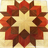 "Hackberry Carpenters Wheel Quilt Block<br />   This is a ""Hackberry Carpenters Wheel"" quilt block. It is made using diamonds and triangles from different kinds of wood, all in their natural colors. There are 80 pieces on this block, 32 diamonds and 48 triangles, all full size. It measures 7"" square. To finish them, I use 5 or 6 coats of a clear wiping varnish, rubbed in by hand. <br />    The type of wood is listed on the bottom from the center out. On this quilt block the wood is ""Hackberry"", ""Walnut"", and ""Cedar"" from Missouri."