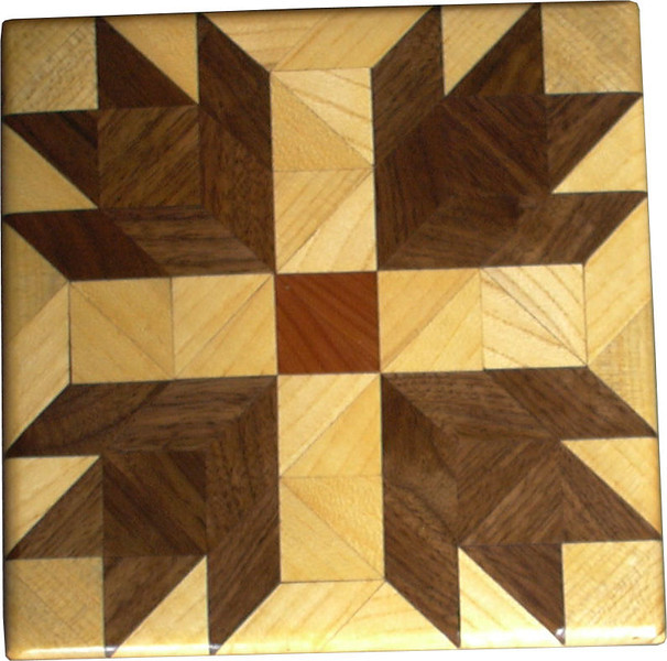 """Bears Paw Quilt Block<br /> This is a """"Bears Paw"""" quilt block. It is made using diamonds and triangles from different kinds of wood, all in their natural colors. There are 74 pieces on this block, 20 diamonds and 54 triangles, all full size. It measures 6 5/8"""" square. To finish them, I use one coat of varnish brushed on and 2 or 3 coats of a clear wiping varnish, rubbed in by hand. <br />    The type of wood is listed on the bottom from the center out. On this quilt block the wood is """"Cedar"""" """"Hackberry"""" and """"Walnut"""" from Missouri."""