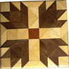 "Bears Paw Quilt Block<br /> This is a ""Bears Paw"" quilt block. It is made using diamonds and triangles from different kinds of wood, all in their natural colors. There are 74 pieces on this block, 20 diamonds and 54 triangles, all full size. It measures 6 5/8"" square. To finish them, I use one coat of varnish brushed on and 2 or 3 coats of a clear wiping varnish, rubbed in by hand. <br />    The type of wood is listed on the bottom from the center out. On this quilt block the wood is ""Cedar"" ""Hackberry"" and ""Walnut"" from Missouri."