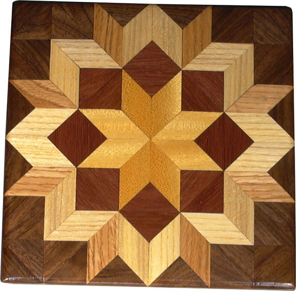 """Bright Carpenters Wheel Quilt Block<br /> This is a """"Carpenters Wheel"""" quilt block. It is made using diamonds and triangles from different kinds of wood, all in their natural colors. I used some bright exotic wood on this one. There are 80 pieces on this block, 32 diamonds and 48 triangles, all full size. It measures 7"""" square. To finish them, I use 3 or 4 coats of a clear wiping varnish, rubbed in by hand. <br />    The type of wood is listed on the bottom from the center out. On this quilt block the wood is """"Satinwood"""" from Brazil, """"Purple Heart"""" from Central or South America and """"Hackberry"""", """"Oak"""" and """"Walnut"""" from Missouri."""