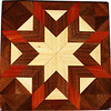 "Hackberry Morning Star with Bright Cedar Quilt Block<br /> This is a Hackberry ""Morning Star"" quilt block with bright cedar. It is made using diamonds and triangles from different kinds of wood, all in their natural colors. There are 80 pieces on this block, 32 diamonds and 48 triangles, all full size. It measures 7"" square. To finish them, I use one coat of varnish brushed on and 2 or 3 coats of a clear wiping varnish, rubbed in by hand. <br /> <br /> The type of wood is listed on the bottom from the center out. On this quilt block the wood is ""Hackberry"" ""Walnut"" and ""Cedar"" from Missouri."