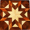 "Hackberry Morning Star with Striped Cedar Quilt Block<br /> This is a Hackberry ""Morning Star"" quilt block with stripped cedar. It is made using diamonds and triangles from different kinds of wood, all in their natural colors. There are 80 pieces on this block, 32 diamonds and 48 triangles, all full size. It measures 7"" square. To finish them, I use one coat of varnish brushed on and 2 or 3 coats of a clear wiping varnish, rubbed in by hand. <br /> <br /> The type of wood is listed on the bottom from the center out. On this quilt block the wood is ""Hackberry"" ""Walnut"" and ""Cedar"" from Missouri."