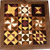 "Sampler Quilt Block<br />   Here is a wood inlay ""Quilt Sampler"" that will beatify any sewing room wall or any wall for that matter.  It is made from 400 diamonds and triangles cut from seven different kinds of wood.  It is finished in all their natural colors, no stains or dyes.  It measures 16"" x 16"" square.  <br /> <br />   The wood is listed on the back from the center out.  The center wood is ""Purpleheart"" from Central or South America, ""Wenge"" from West Africa, ""Satinwood"" from Brazil, (Satinwood is the most beautiful yellow color with a satin look.), ""Lacewood"" from Australia, (Lacewood has a pretty copper color with rays in the grain.), ""Imbuia"" from Brazil, and ""Hackberry"" and ""Walnut from Missouri""."