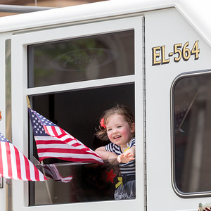 Little girl participates in Flag Day Parade