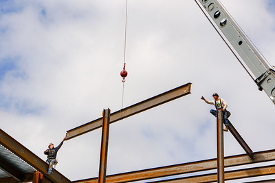 Construction workers placing an Ibeam