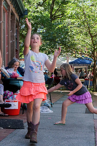 Girls chases bubbles during Troy fest