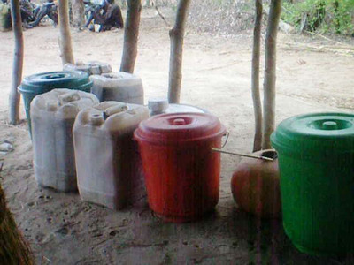 Wine for the celebration brewed in buckets and jerrycans.