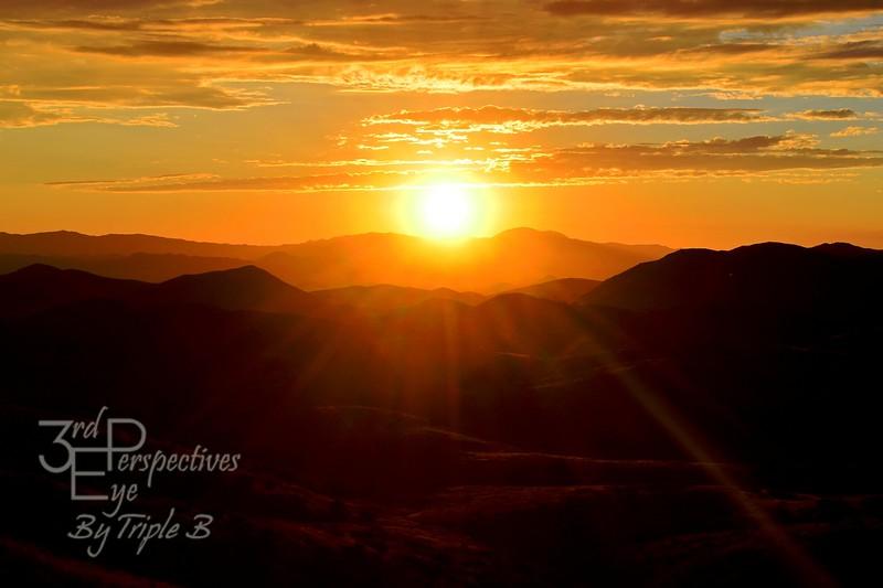 Sunburst Over the Meadows