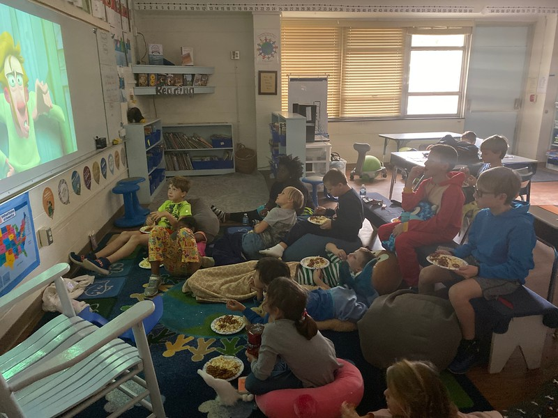 Enjoying a movie afternoon celebration for filling our class marble jar
