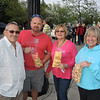 Steve and Diane Ott...he in white. she in blue. Gene Harmych and Janet McKillip enjoying POPPING AROUND pop corn.