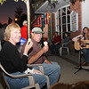 Liz and friend at dusk, listening to Michelle at Main Street Soda Shop.