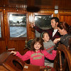 Th Prideaux family....in pink-Veronica, Grey-Sophia, Dad-Simon and Jaime, from Vermilion having fun in the pilot house-first time in 15 years for the adults.