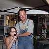 Daughter Megan trying Karaoke while Dad Scott watching.