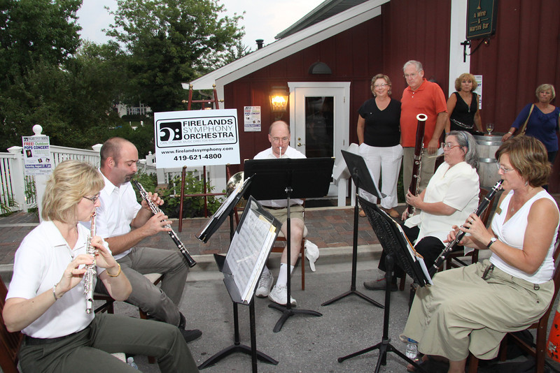The Firelands Symphony Quintet performing at Chez Francois--in background, are<br /> Therese and Dave Hoffman.