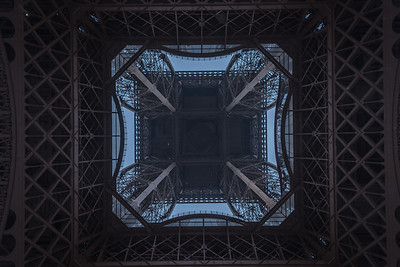 Looking up the center of the Eiffel Tower