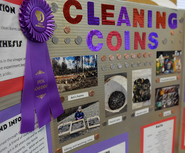 A science fair project on cleaning coins salvaged from the camp fire won a special achievement award at the Chico Science Fair inside the Chico Masonic Family Center on Wednesday, February 27. (Matt Bates -- Enterprise Record)