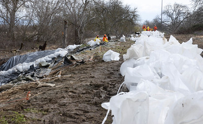 A crew works to reinforce the J levee near Hamilton City ahead of a predicted rise in water levels on Wednesday, February 27. (Matt Bates -- Enterprise Record)