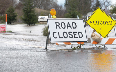 Heavy rain has caused flooding and multiple  road closures. This sign was set up near  Meridian Road just north of Chico on Wednesday, February 27. (Matt Bates -- Enterprise Record)