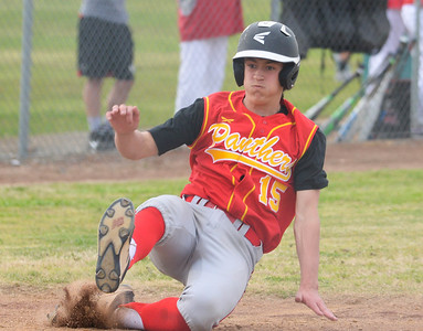 Chico High's Ryan Edwards slides safely in to home plate during the Pather's game at Las Plumas on Tuesday, March 19. (Matt Bates -- Enterprise-Record)
