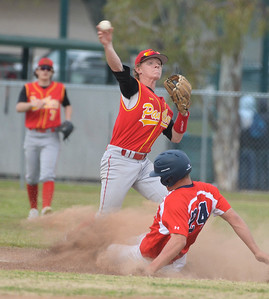 Chico High's  Josh Taylor attempts to turn a double play during the Pather's game at Las Plumas on Tuesday, March 19. (Matt Bates -- Enterprise-Record)