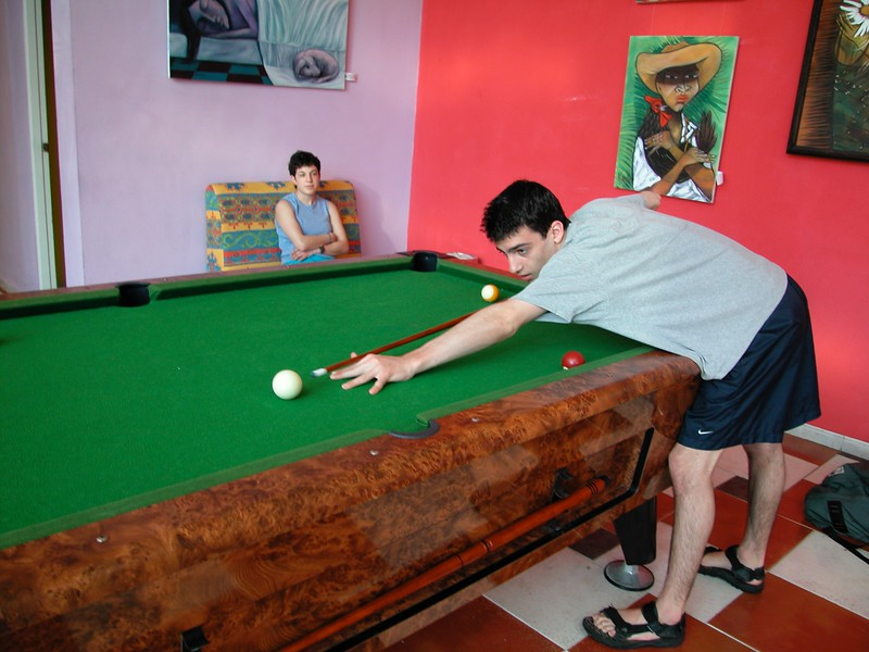 Lonny Playing Pool on Vacation