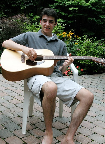 Lonny Playing Guitar in Back Yard