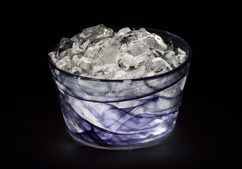 Two textured images - a studio shot of a glass bowl of ice.