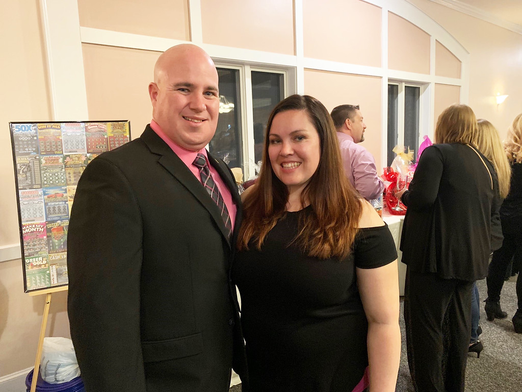 . Jonathan Couture, a Chelmsford Pop Warner board member, and committee member Stephanie DeJesus, both of Chelmsford