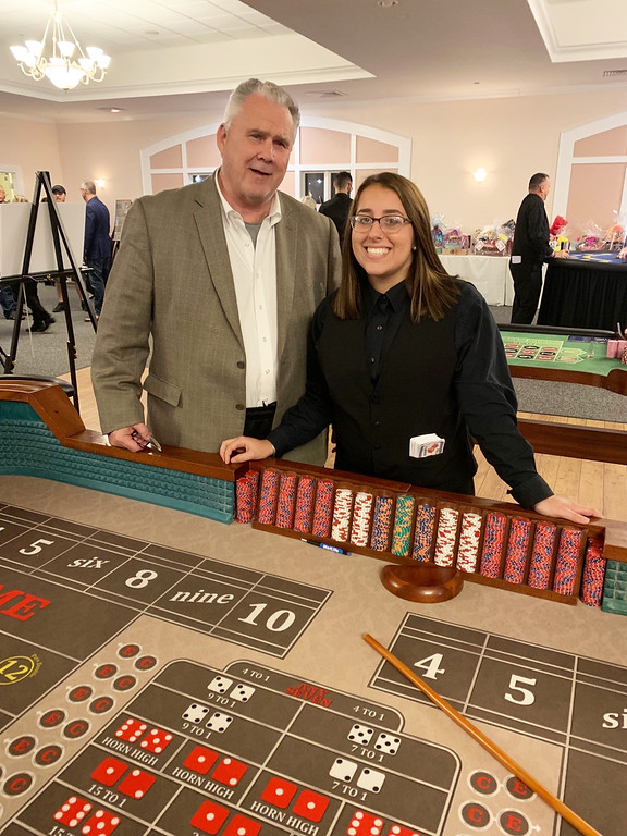 . Chelmsford Selectman George Dixon rolls the dice.